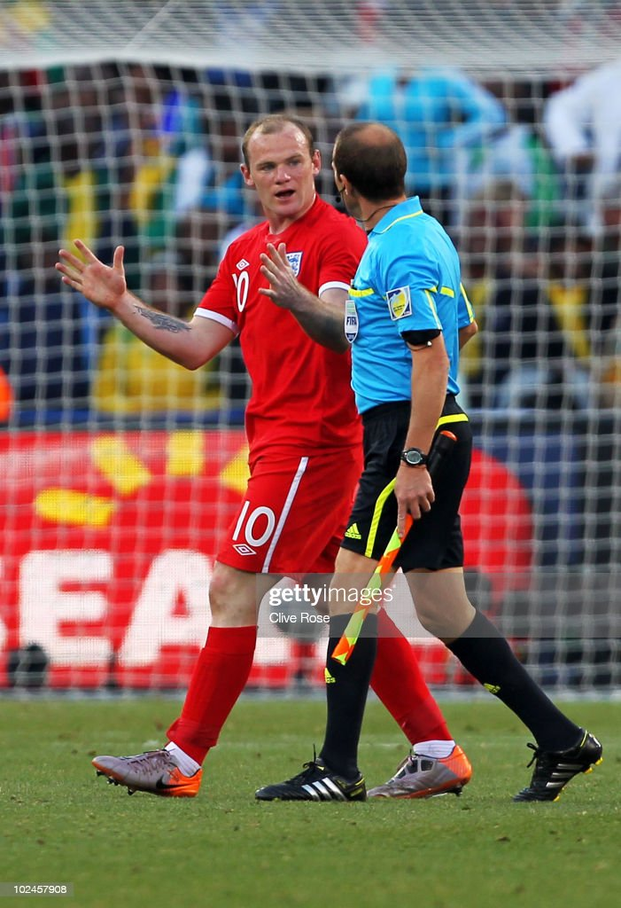 Wayne Rooney of England askes referee assistant Mauricio Espinosa about the incident where the ball crossed the line during the 2010 FIFA World Cup South Africa Round of Sixteen match between Germany and England at Free State Stadium on June 27, 2010 in Bloemfontein, South Africa.