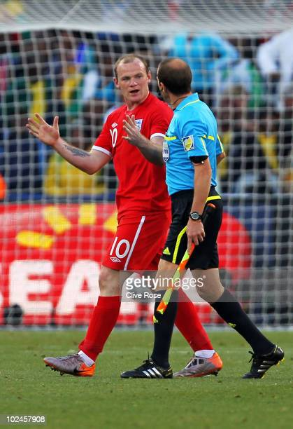 Wayne Rooney of England askes referee assistant Mauricio Espinosa about the incident where the ball crossed the line during the 2010 FIFA World Cup...
