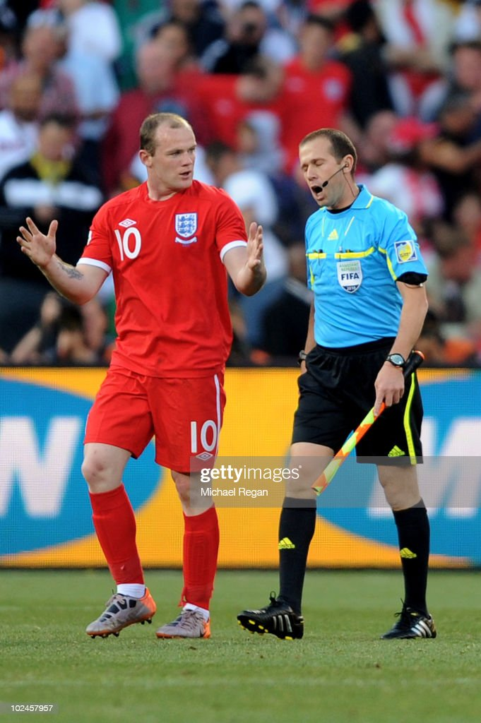 Wayne Rooney of England asks referee assistant Mauricio Espinosa about the incident where the ball crossed the line during the 2010 FIFA World Cup South Africa Round of Sixteen match between Germany and England at Free State Stadium on June 27, 2010 in Bloemfontein, South Africa.