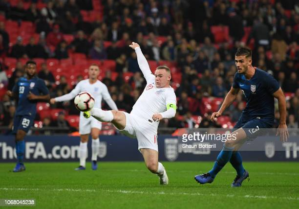 Wayne Rooney of England attempts to reach the ball as Matthew Miazga of United States looks on during the International Friendly match between...