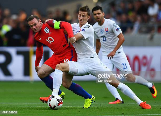 Wayne Rooney of England battles with Jan Gregus of Slovakia during the 2018 FIFA World Cup Group F qualifying match between Slovakia and England at...