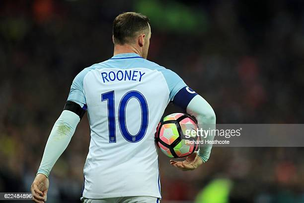 Wayne Rooney of England carries the match ball during the FIFA 2018 World Cup qualifying match between England and Scotland at Wembley Stadium on...