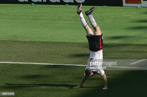 Wayne Rooney of England celebrates after scoring during the UEFA Euro 2004 Group B match between England and Switzerland at the Estadio Cidade de...