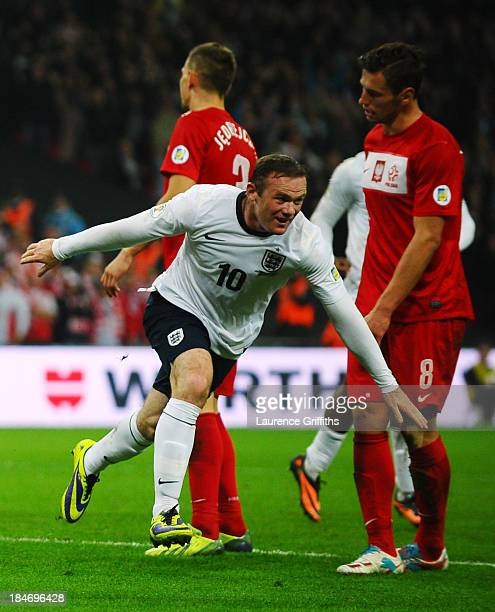 Wayne Rooney of England celebrates after scoring his team's opening goal during the FIFA 2014 World Cup Qualifying Group H match between England and...