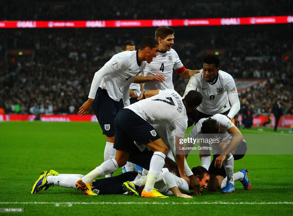 Wayne Rooney of England celebrates after scoring his team's opening goal during the FIFA 2014 World Cup Qualifying Group H match between England and Poland at Wembley Stadium on October 15, 2013 in London, England.