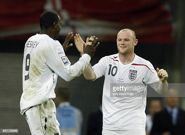 Wayne Rooney of England celebrates scoring his second goal with Emile Heskey of England against Kazakhstan during the FIFA World Cup European...