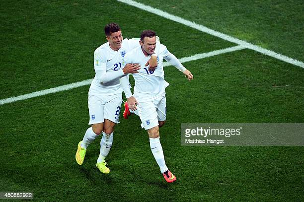 Wayne Rooney of England celebrates scoring his team's first goal with Ross Barkley during the 2014 FIFA World Cup Brazil Group D match between...