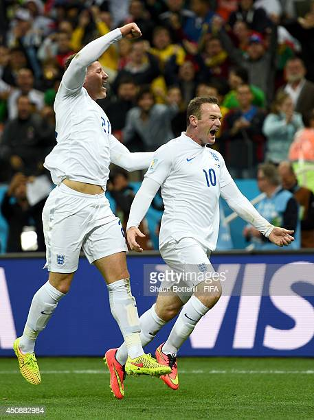 Wayne Rooney of England celebrates scoring his team's first goal with his teammates Ross Barkley during the 2014 FIFA World Cup Brazil Group D match...