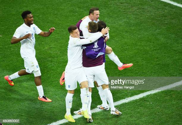 Wayne Rooney of England celebrates scoring his team's first goal with teammates during the 2014 FIFA World Cup Brazil Group D match between Uruguay...