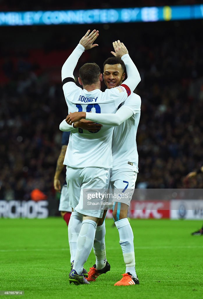 Wayne Rooney (L) of England celebrates scoring his team's second goal with his team mate Dele Alli (R) during the International Friendly match between England and France at Wembley Stadium on November 17, 2015 in London, England.