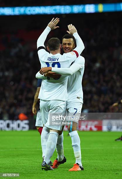 Wayne Rooney of England celebrates scoring his team's second goal with his team mate Dele Alli during the International Friendly match between...
