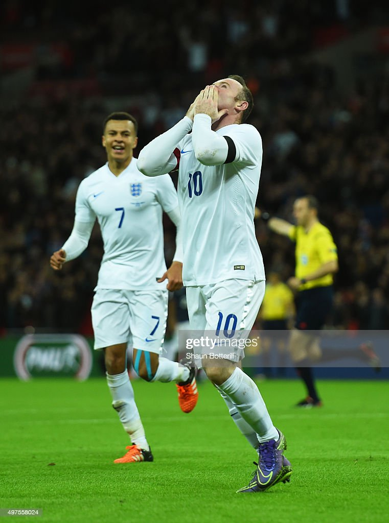 Wayne Rooney (R) of England celebrates scoring his team's second goal with his team mate Dele Alli (L) during the International Friendly match between England and France at Wembley Stadium on November 17, 2015 in London, England.