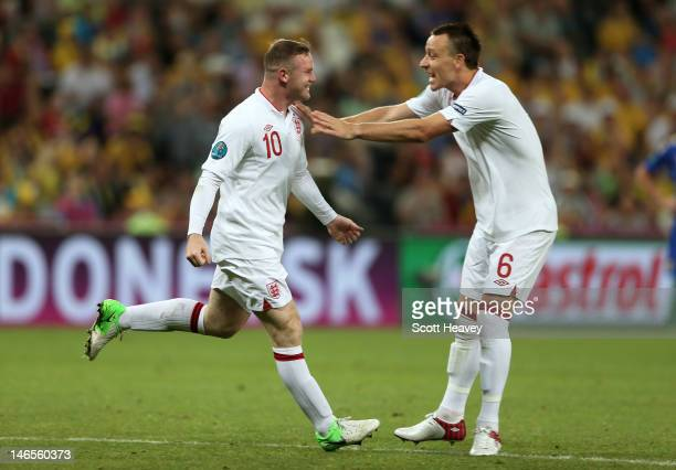 Wayne Rooney of England celebrates scoring their first goal with John Terry of England during the UEFA EURO 2012 group D match between England and...
