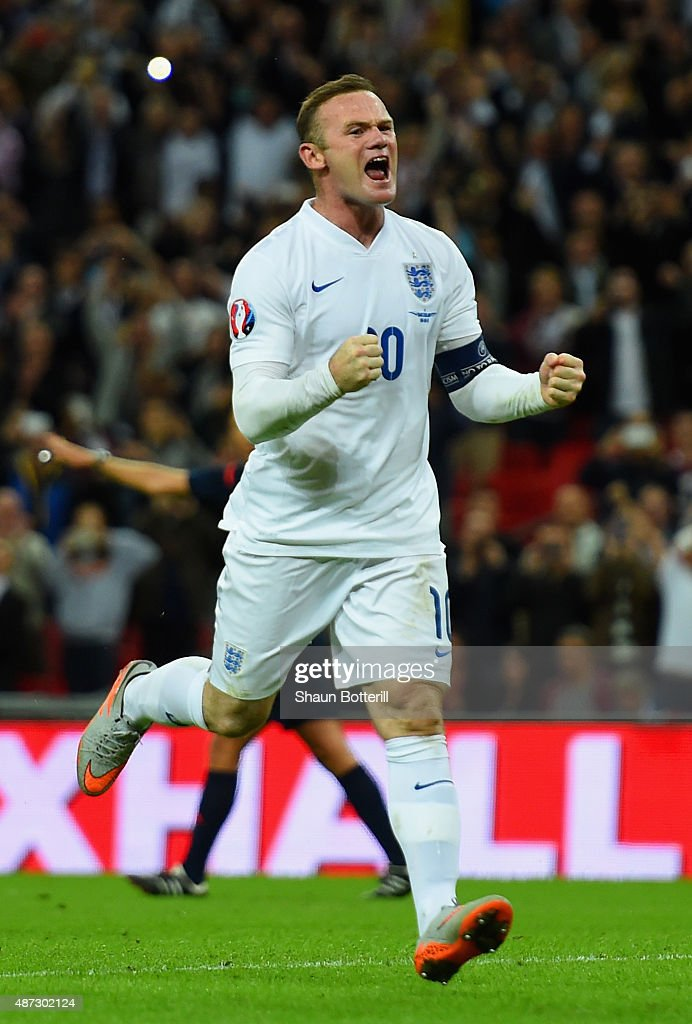 Wayne Rooney of England celebrates scoring their second goal from the penalty spot during the UEFA EURO 2016 Group E qualifying match between England and Switzerland at Wembley Stadium on September 8, 2015 in London, United Kingdom. Wayne Rooney's 50th goal breaks the record for most international goals scored for England. Sir Bobby Charlton held the record previously with 49 goals.