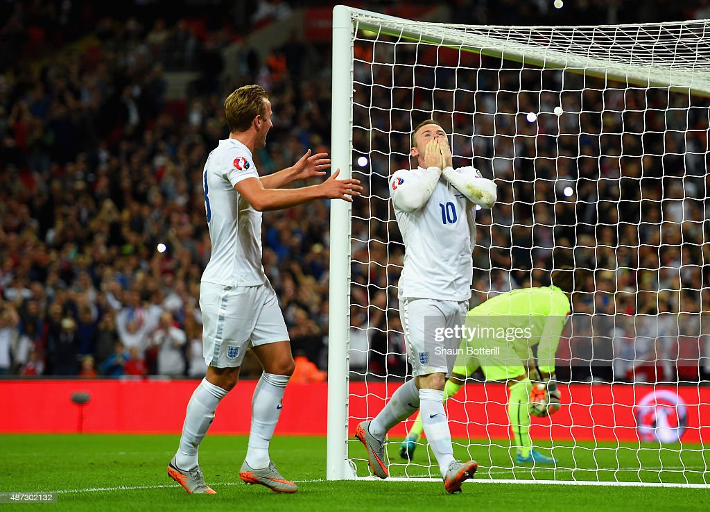 Wayne Rooney of England celebrates scoring their second goal from the penalty spot with Harry Kane of England during the UEFA EURO 2016 Group E qualifying match between England and Switzerland at Wembley Stadium on September 8, 2015 in London, United Kingdom. Wayne Rooney's 50th goal breaks the record for most international goals scored for England. Sir Bobby Charlton held the record previously with 49 goals.