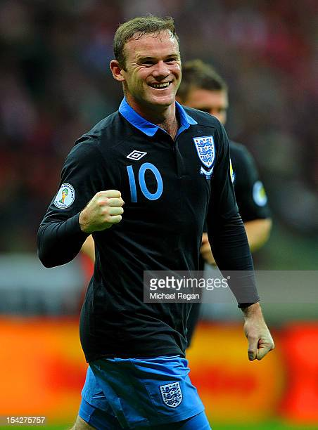 Wayne Rooney of England celebrates scoring to make it 10 during the FIFA 2014 World Cup Qualifier between Poland and England at the National Stadium...