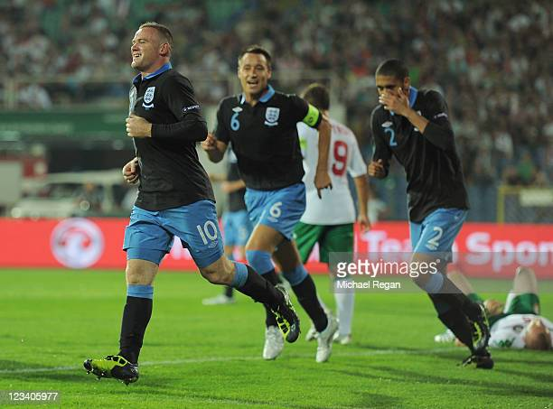 Wayne Rooney of England celebrates scoring to make it 20 with John Terry and Chris Smalling during the EURO 2012 group G qualifying match between...