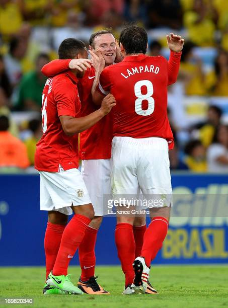Wayne Rooney of England celebrates scorong the second goal during the International Friendly match between England and Brazil at Maracana on June 2...