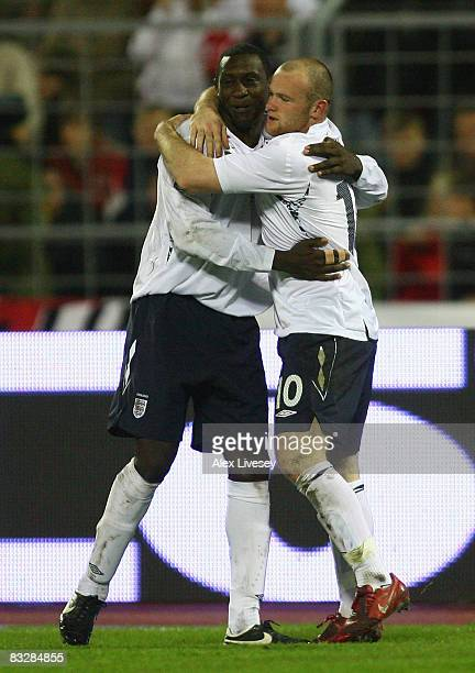 Wayne Rooney of England celebrates with Emile Heskey after scoring his goal during the FIFA2010 World Cup Qualifying match between Belarus and...