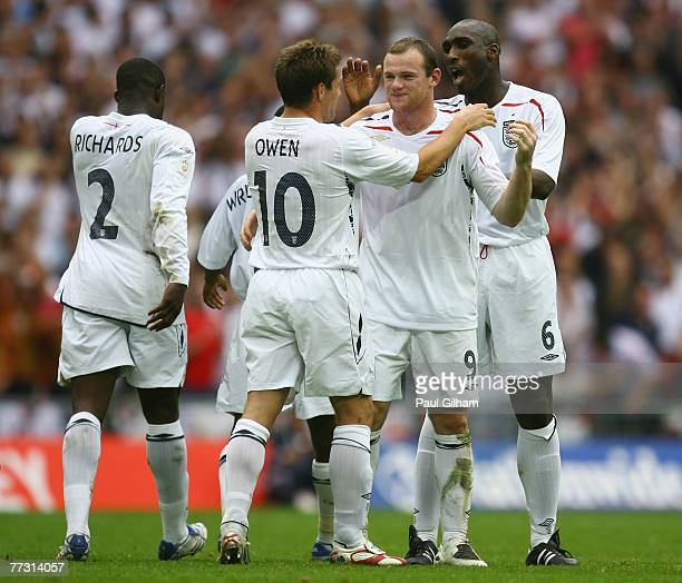 Wayne Rooney of England celebrates with team mates Michael Owen and Sol Campbell as he scores their second goal during the Euro 2008 Group E...