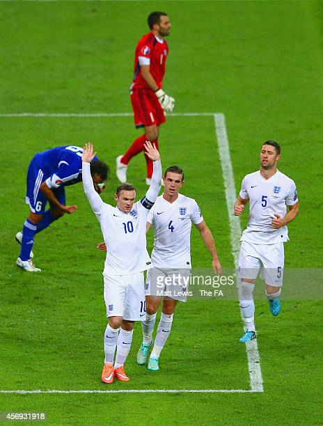 Wayne Rooney of England celebrates with teammates after scoring his team's second goal from the penalty spot during the EURO 2016 Qualifier match...