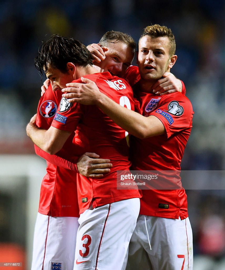 Wayne Rooney (C) of England celebrates with teammates Leighton Baines (L) and Jack Wilshere (R) after scoring the opening goal from a free kick during the EURO 2016 Qualifier match between Estonia and England at A. Le Coq Arena on October 12, 2014 in Tallinn, Estonia.