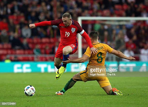 Wayne Rooney of England challenged by Bailey Wright of Australia during the International Friendly match between England and Australia at Stadium of...