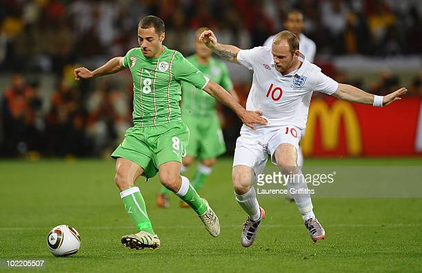 Wayne Rooney of England challenges Medhi Lacen of Algeria during the 2010 FIFA World Cup South Africa Group C match between England and Algeria at...