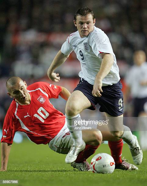 Wayne Rooney of England clashes with Mariusz Lewandowski of Poland during the World Cup qualifying match between England and Poland at Old Trafford...