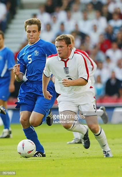Wayne Rooney of England clashes with Radoslav Zabavnik of Slovakia during the England v Slovakia European Championship 2004 qualifying match on June...