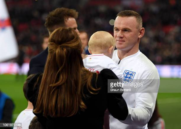 Wayne Rooney of England collects his son Cass Mac Rooney from his wife Coleen Rooney prior to the International Friendly match between England and...