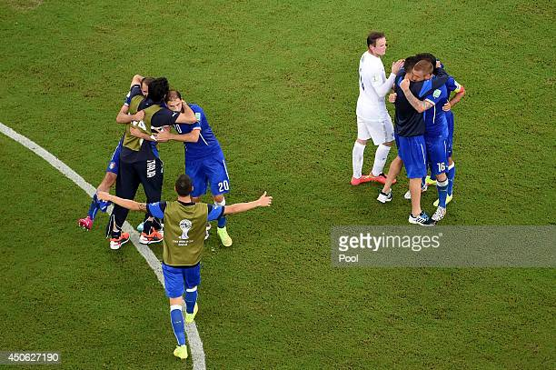 Wayne Rooney of England congratulates Italy as they celebrate their win during the 2014 FIFA World Cup Brazil Group D match between England and Italy...