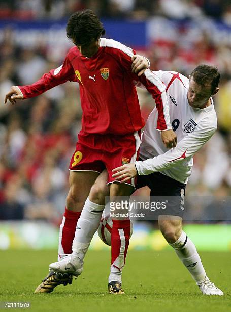 Wayne Rooney of England fights for the ball with Goran Maznov of Macedonia during the Euro 2008 Qualifying match between England and Macedonia at Old...
