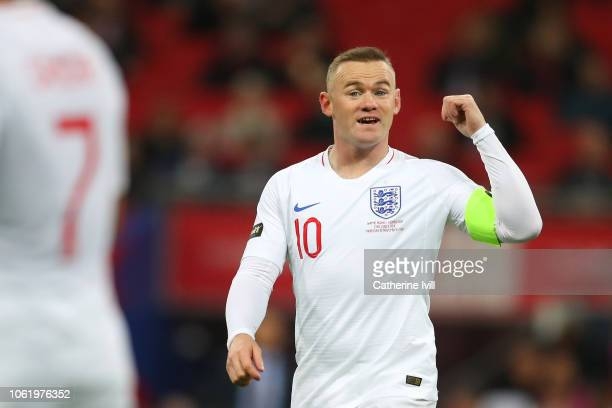 Wayne Rooney of England gives his team instructions as he comes on with the captains armband armband on during the International Friendly match...