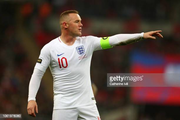 Wayne Rooney of England gives his team instructions during the International Friendly match between England and United States at Wembley Stadium on...