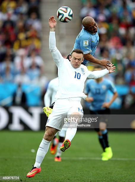Wayne Rooney of England goes up for a header against Egidio Arevalo Rios of Uruguay during the 2014 FIFA World Cup Brazil Group D match between...
