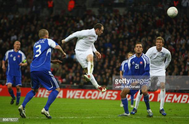Wayne Rooney of England heads England's second goal during the International Friendly match between England and Slovakia at Wembley Stadium on March...