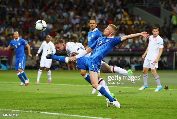 Wayne Rooney of England heads towards goal as Ignazio Abate of Italy challenges during the UEFA EURO 2012 quarter final match between England and...