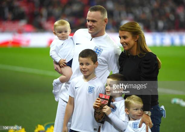 Wayne Rooney of England his wife Coleen Rooney and their children Kit Joseph Ronney Klay Anthony Rooney Kai Wayne Rooney and Cass Mac Rooney pose for...