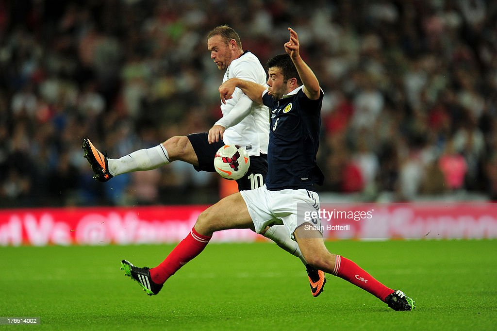Wayne Rooney of England (L) in action against Grant Hanley of Scotland during the International Friendly match between England and Scotland at Wembley Stadium on August 14, 2013 in London, England.