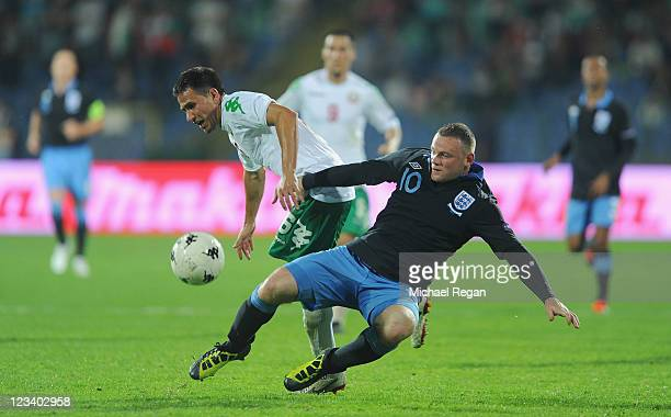 Wayne Rooney of England in action with Zhivko Milanov of Bulgaria during the EURO 2012 group G qualifying match between Bulgaria and England at the...
