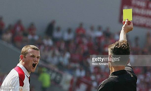 Wayne Rooney of England is booked by the referee for his tackle on goalkeeper Jorg Steil of Switzerland during the UEFA Euro 2004 Group B match...