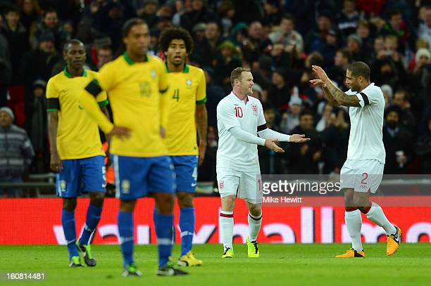 Wayne Rooney of England is congratulated by team-mate Glen Johnson of England after he scored the opening goal during the International friendly...