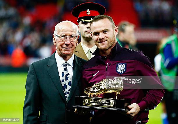 Wayne Rooney of England is presented with the Golden Boot by Sir Bobby Charlton after breaking his record of 49 goals prior to the UEFA EURO 2016...