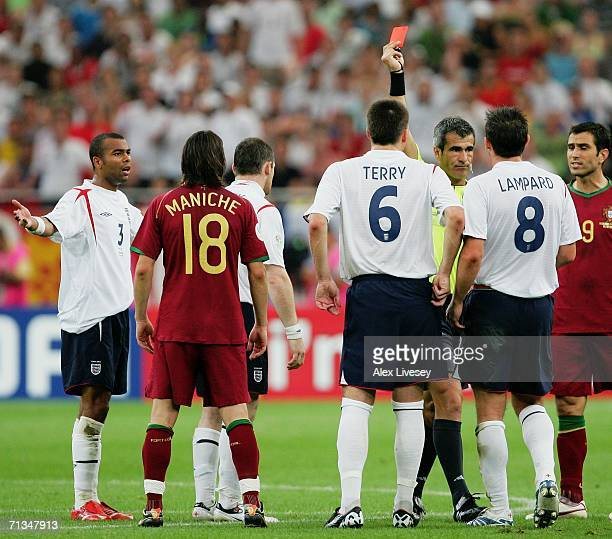 Wayne Rooney of England is shown a red card by Referee Horacio Elizondo of Argentina during the FIFA World Cup Germany 2006 Quarterfinal match...