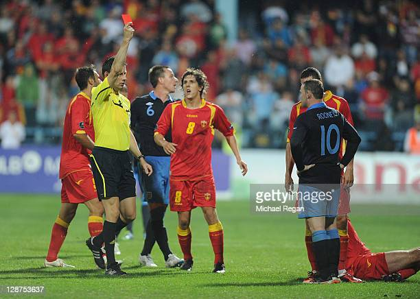 Wayne Rooney of England is shown the red card after fouling Miodrag Dzudovic of Montenegro during the UEFA EURO 2012 group G qualifier match between...