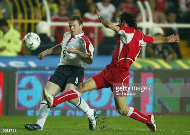 Wayne Rooney of England is tackled by Ibrahim Uzumlez of Turkey during the UEFA European Championships Group Nine Qualifying match between Turkey and...