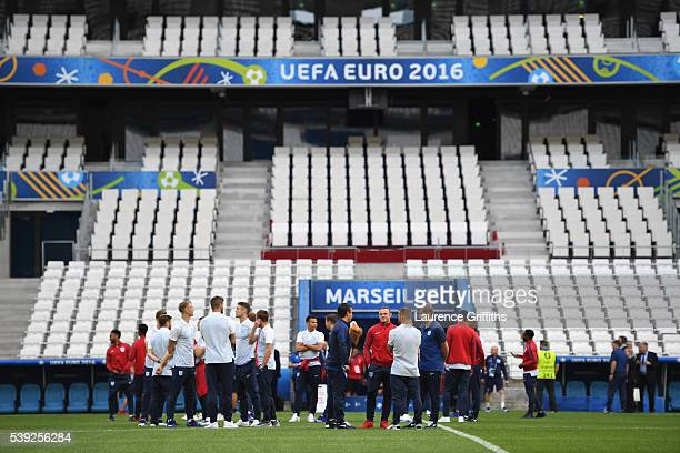 Wayne Rooney of England leads the team out to view the stadium during an England training session ahead of the EURO 2016 Group B match against...