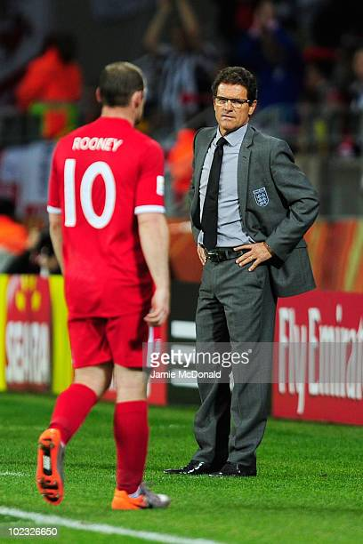 Wayne Rooney of England leaves the pitch after being substituted by Fabio Capello manager of England during the 2010 FIFA World Cup South Africa...