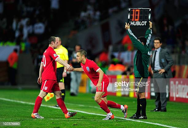 Wayne Rooney of England leaves the pitch after being substituted for Joe Cole by Fabio Capello manager of England during the 2010 FIFA World Cup...